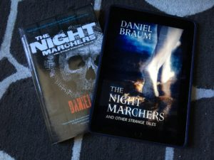 Physical edition of Dan Braum's The Night Marchers along with ebook on an iPad
